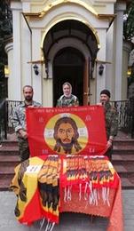 В донецком храме для боевиков освятили знамя с изображением Спаса
